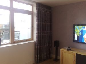 Curtain track fitted by laskeys