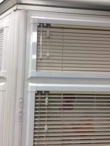 Close up of Bespoke white venetian Blinds from blind and curtain company in Tewkesbury