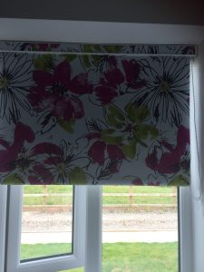 Floral roller blind installed by Tewkesbury based blind and curtain company