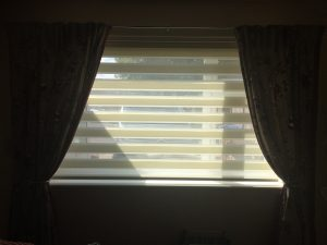 Cream roman blind installed by Tewkesbury based blind and curtain company