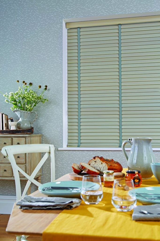 Pale green venetian blinds from curtain and blind specialist in Gloucestershire